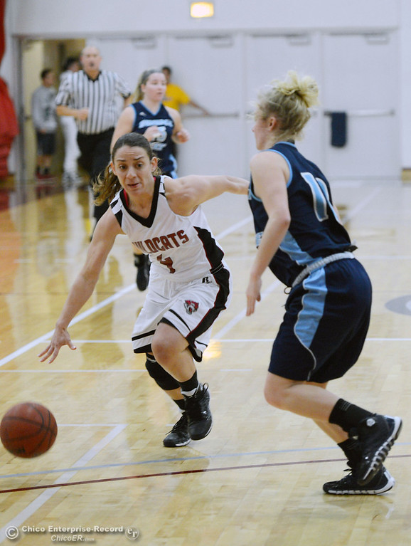 Description of . Chico State\'s #4 Sarah Rebibo (left) dribbles against Sonoma State\'s #10 Tanner Adams (right) in the second half of their women\'s basketball game at CSUC Acker Gym Friday January 31, 2014 in Chico, Calif. (Jason Halley/Chico Enterprise-Record)