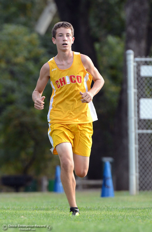 Description of . Chico High's Liam Monninger finishes against Pleasant Valley High varsity boys cross country race at Hooker Oak Wednesday, October 2, 2013, in Chico, Calif.  (Jason Halley/Chico Enterprise-Record)