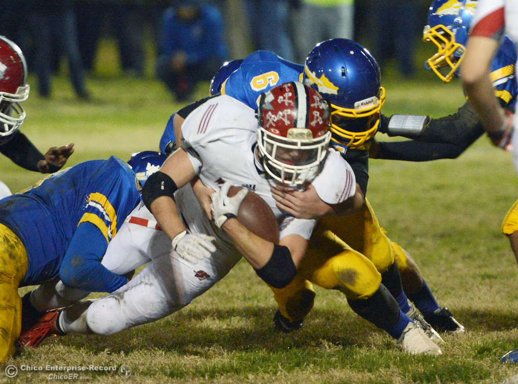 Description of . Hamilton High\'s #68 Riley Meridith (back) tackles against Winters High\'s #4 Chaz Matthews (front) in the first quarter of their football game at HHS Wednesday, November 27, 2013 in Hamilton City, Calif.  (Jason Halley/Chico Enterprise-Record)