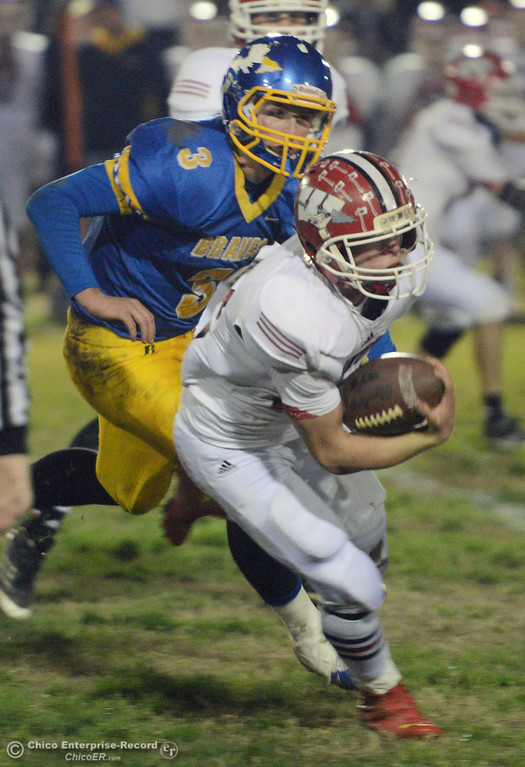 Description of . Winters High\'s #12 Jacob Lowrie (right) runs the ball against Hamilton High\'s #3 Austin Burbank (left) in the first quarter of their football game at HHS Wednesday, November 27, 2013 in Hamilton City, Calif.  (Jason Halley/Chico Enterprise-Record)
