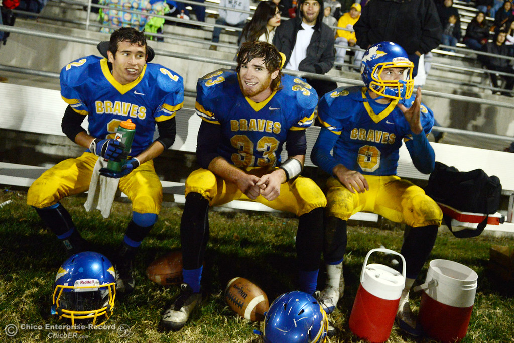 Description of . Hamilton High\'s #2 Theron Fumasi, #33 Andrew Shippelhoute, and #3 Austin Burbank (left to right) sit on the bench against Winters High in the fourth quarter of their football game at HHS Wednesday, November 27, 2013 in Hamilton City, Calif.  (Jason Halley/Chico Enterprise-Record)