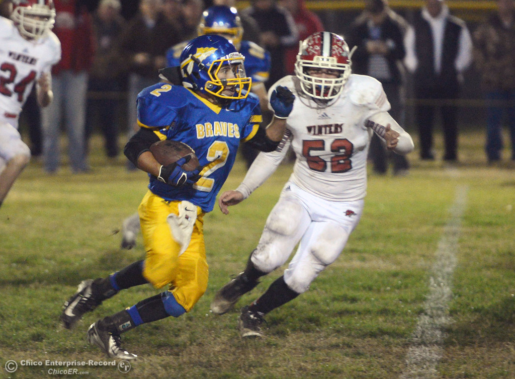 Description of . Hamilton High\'s #2 Theron Fumasi (left) rushes against Winters High\'s #52 Ka\'mi Drumright (right) in the third quarter of their football game at HHS Wednesday, November 27, 2013 in Hamilton City, Calif.  (Jason Halley/Chico Enterprise-Record)