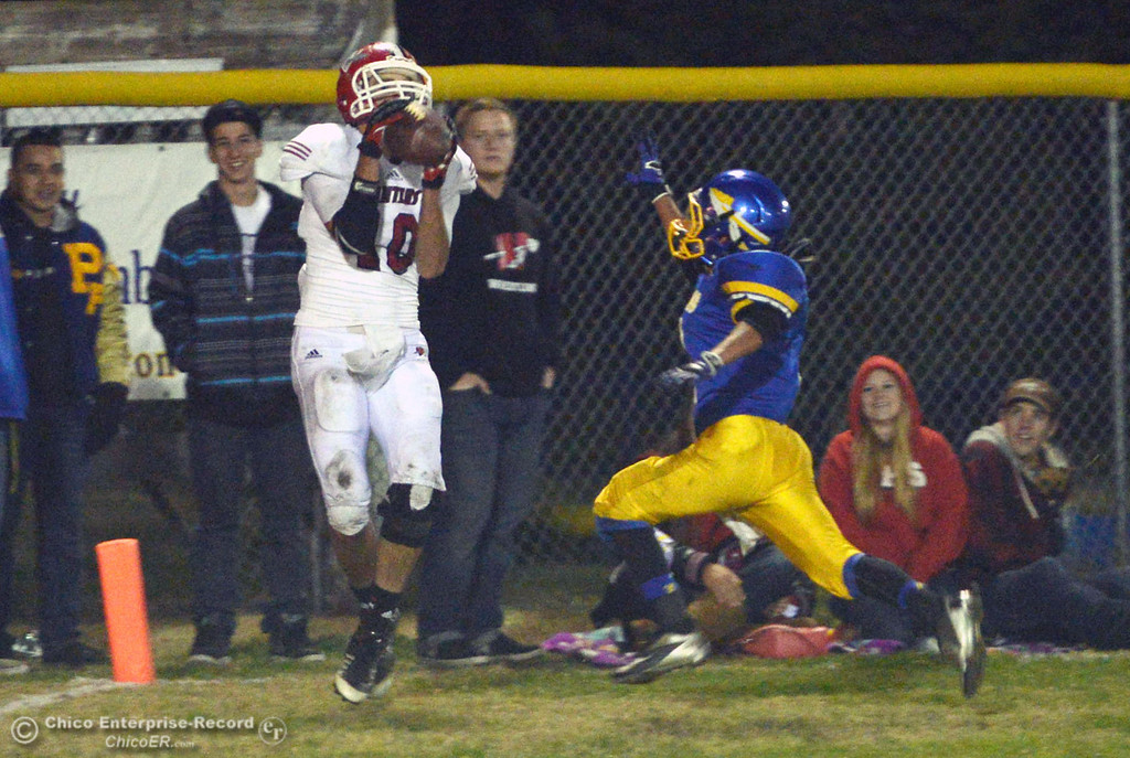 Description of . Winters High\'s #10 Ben Case (left) completes a catch against Hamilton High\'s #2 Theron Fumasi (right) in the third quarter of their football game at HHS Wednesday, November 27, 2013 in Hamilton City, Calif.  (Jason Halley/Chico Enterprise-Record)