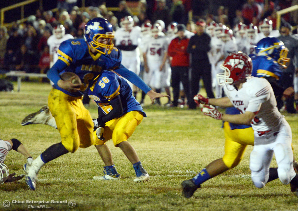 Description of . Hamilton High\'s #3 Austin Burbank (left) rushes against Winters High\'s #21 Trevor Ray (right) in the second quarter of their football game at HHS Wednesday, November 27, 2013 in Hamilton City, Calif.  (Jason Halley/Chico Enterprise-Record)
