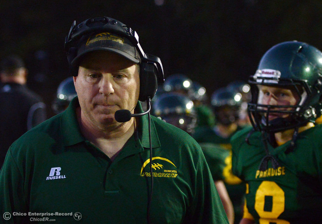 Description of . Paradise High head coach Eric Prinz looks on against Grant High in the second quarter of their football game at PHS Friday, August 30, 2013 in Paradise, Calif.  (Jason Halley/Chico Enterprise-Record)