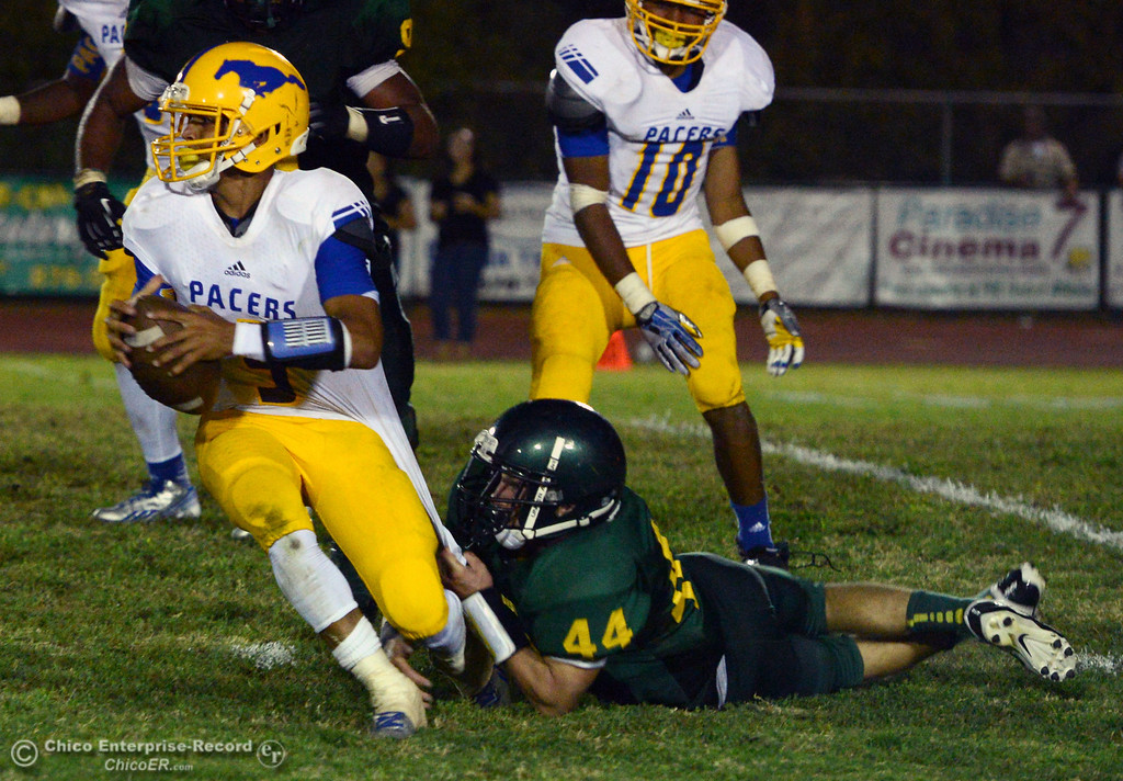 . Paradise High\'s #44 James Hingst (right) tackles Grant High\'s #9 Donovan Brown (left) during the second quarter of their football game at PHS on Friday, August 30, 2013 in Paradise, Calif.  (Jason Halley/Chico Enterprise-Record)