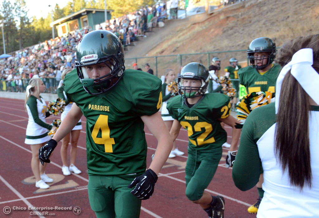 Description of . Paradise High's #4 Trey Miskimen (left) and #22 Jordan Green (right) enter the field against Grant High before the first quarter of their football game at PHS Friday, August 30, 2013 in Paradise, Calif.  (Jason Halley/Chico Enterprise-Record)