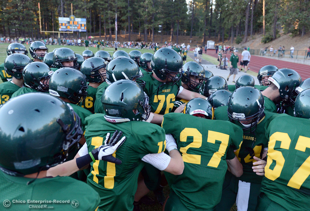 Description of . Paradise High warm up against Grant High before the first quarter of their football game at PHS Friday, August 30, 2013 in Paradise, Calif.  (Jason Halley/Chico Enterprise-Record)