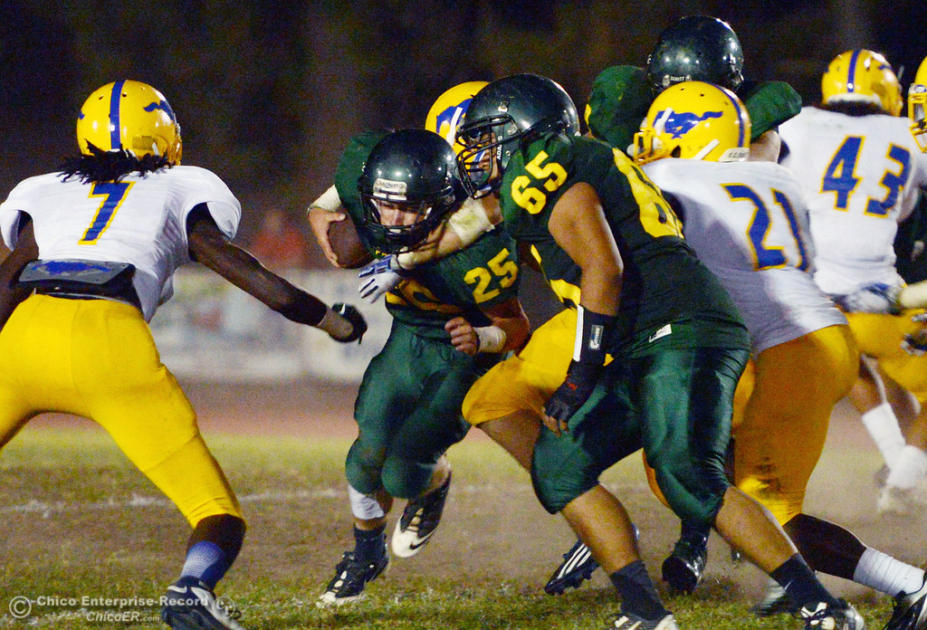 Description of . Paradise High's #25 Matt Machado (left0 is tackled against Grant High in the third quarter of their football game at PHS Friday, August 30, 2013 in Paradise, Calif.  (Jason Halley/Chico Enterprise-Record)