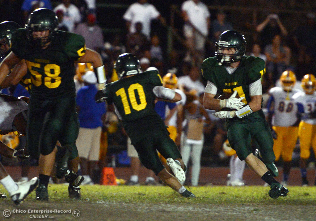 Description of . Paradise High's #11 DJ Norton (right) rushes against Grant High in the fourth quarter of their football game at PHS Friday, August 30, 2013 in Paradise, Calif.  (Jason Halley/Chico Enterprise-Record)