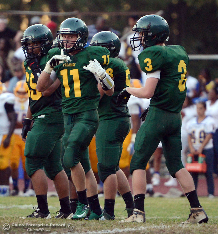 Description of . Paradise High's #65 Cameron Williams, #11 DJ Norton and #3 Tyler Vanlderstine (left to right) ready against Grant High in the first quarter of their football game at PHS Friday, August 30, 2013 in Paradise, Calif.  (Jason Halley/Chico Enterprise-Record)