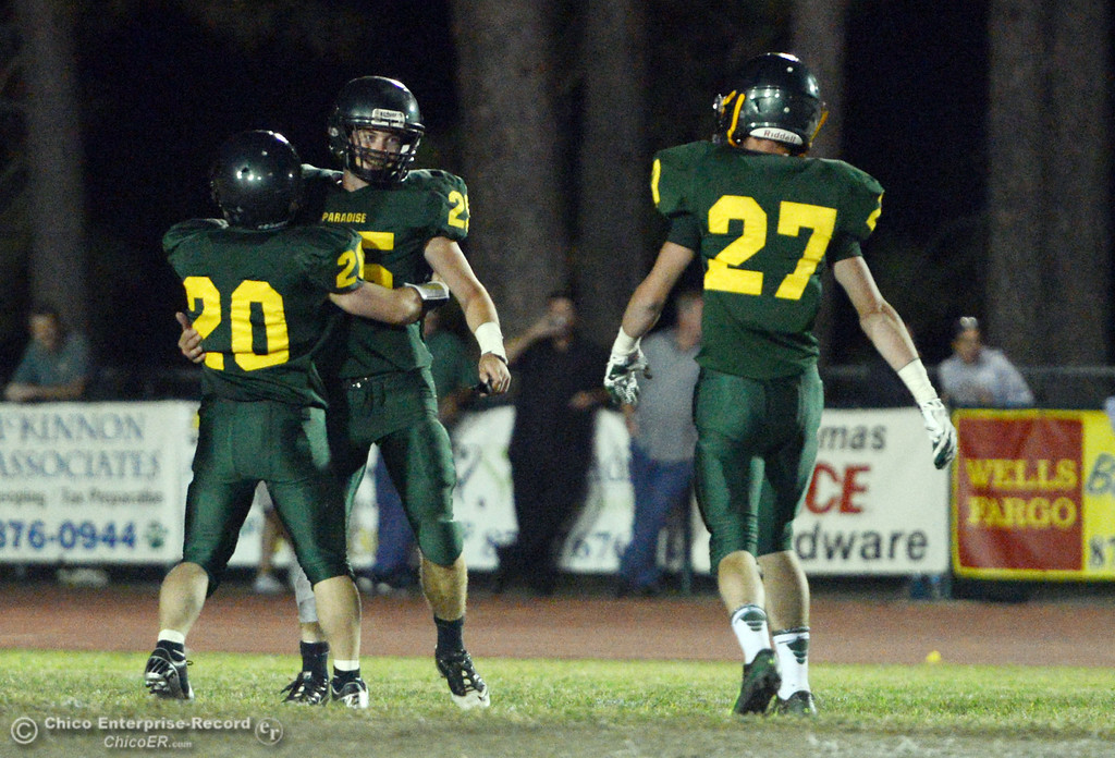 Description of . Paradise High's #20 Wyatt Wyckoff, #25 Matt Machado and #27 Dominic Vannucci (left to right) against Grant High in the third quarter of their football game at PHS Friday, August 30, 2013 in Paradise, Calif.  (Jason Halley/Chico Enterprise-Record)