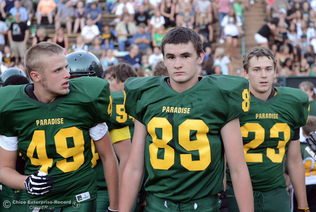 . Paradise High #49 Ronnie Sinclair, #89 James Phillips, and #23 Travis Ferreira (left to right) warm up against Grant High before the first quarter of their football game at PHS Friday, August 30, 2013 in Paradise, Calif.  (Jason Halley/Chico Enterprise-Record)