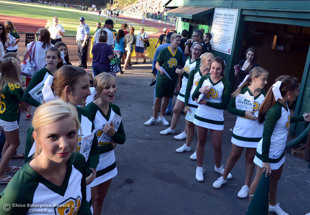 . Paradise High cheerleaders welcome fans to watch against Grant High before the first quarter of their football game at PHS Friday, August 30, 2013 in Paradise, Calif.  (Jason Halley/Chico Enterprise-Record)