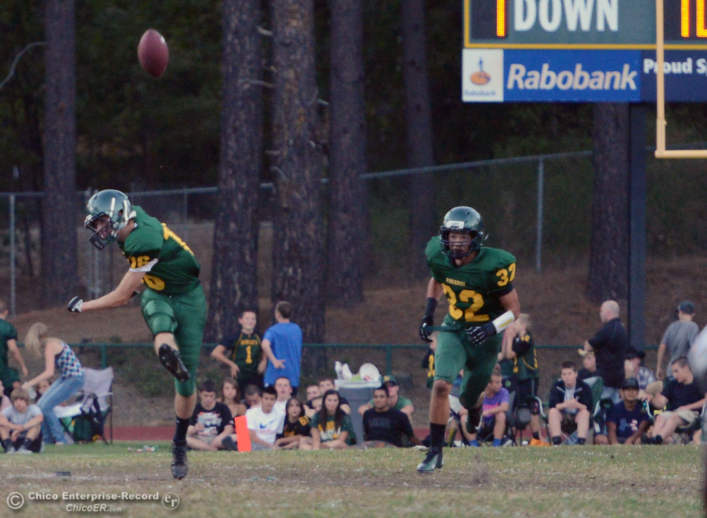 Description of . Paradise High's #16 Sutter Wyatt kicks off against Grant High in the first quarter of their football game at PHS Friday, August 30, 2013 in Paradise, Calif.  (Jason Halley/Chico Enterprise-Record)