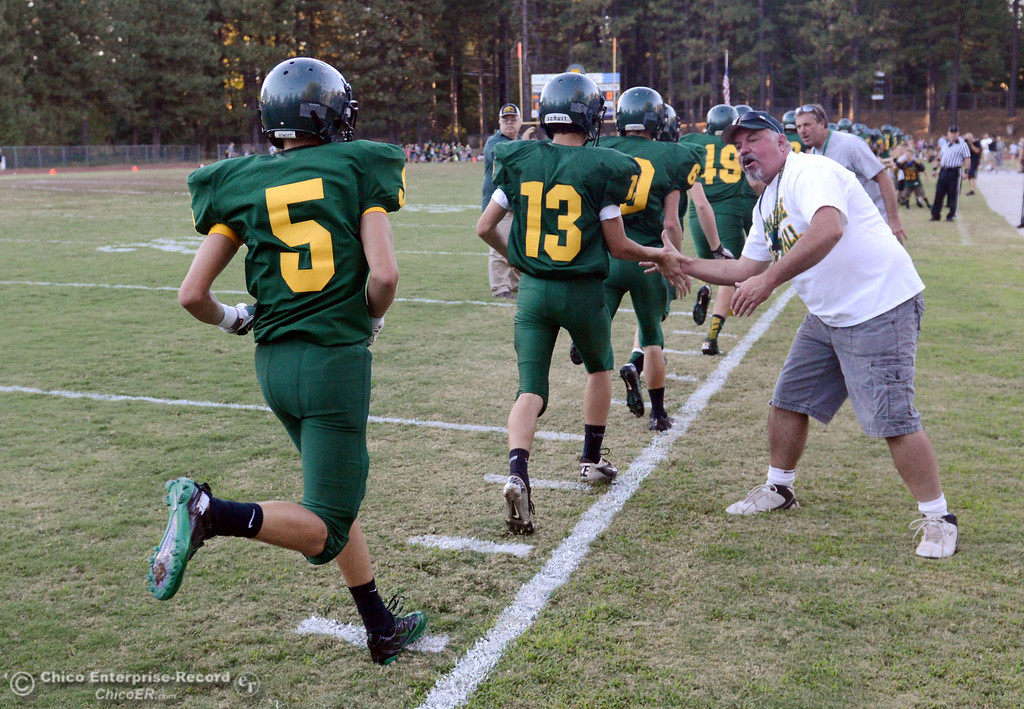 Description of . Paradise High enters the field against Grant High before the first quarter of their football game at PHS Friday, August 30, 2013 in Paradise, Calif.  (Jason Halley/Chico Enterprise-Record)