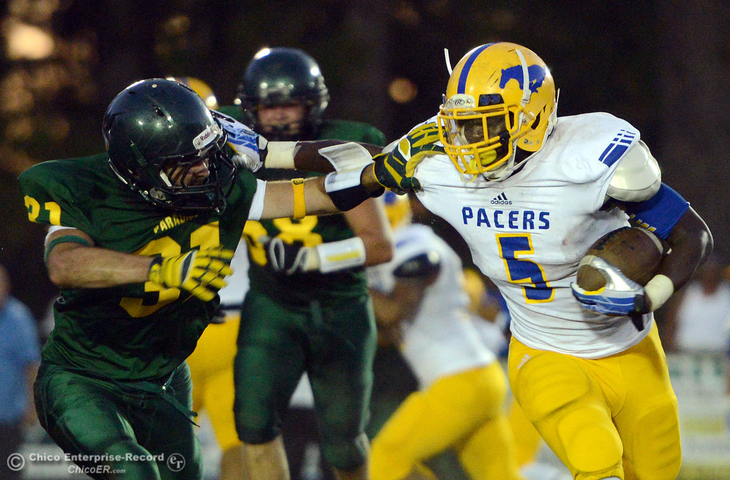 Description of . Paradise High's #31 Gavin Murray (left) defends against Grant High's #5 TieNeal Martin (right) during the second quarter of their football game at PHS on Friday, August 30, 2013 in Paradise, Calif.  (Jason Halley/Chico Enterprise-Record)