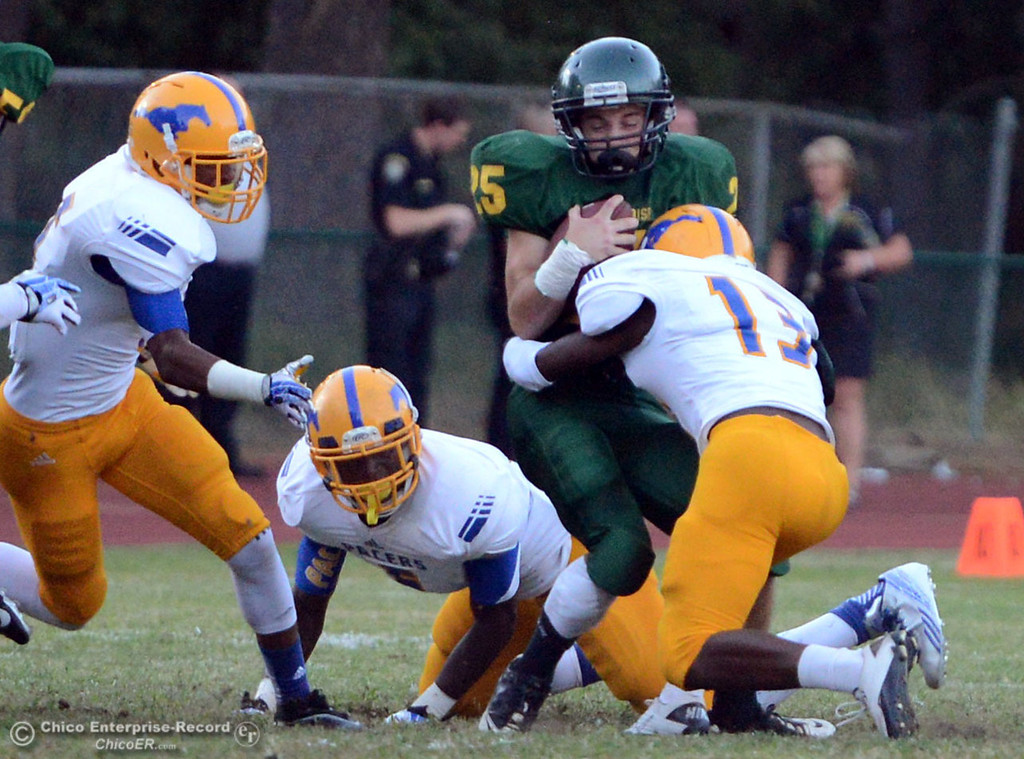 Description of . Paradise High's #25 Matt Machado (left) is tackled against Grant High's #13 DaRon Hill (right) in the first quarter of their football game at PHS Friday, August 30, 2013 in Paradise, Calif.  (Jason Halley/Chico Enterprise-Record)