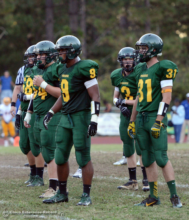 Description of . Paradise High's #9 Jonathon Dixon (left) and #31 Gavin Murray (right) ready against Grant High in the first quarter of their football game at PHS Friday, August 30, 2013 in Paradise, Calif.  (Jason Halley/Chico Enterprise-Record)