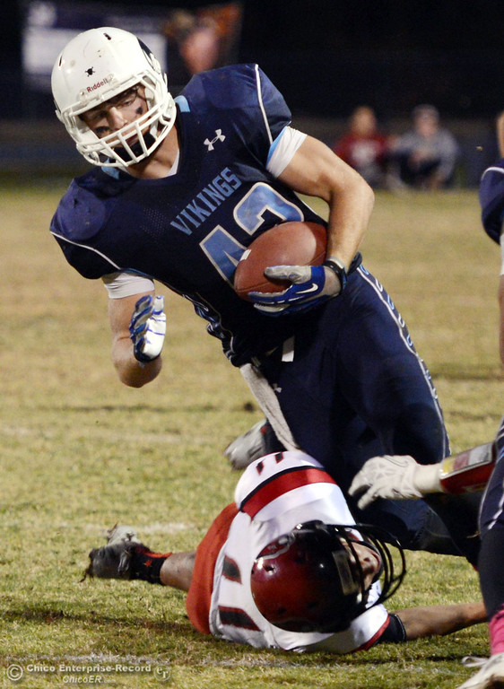 Description of . Pleasant Valley High\'s #42 Chad Olsen (top) is tackled against Foothill High\'s #11 Ryan Terras (bottom) in the second quarter of their football game at PVHS Asgard Yard Friday, October 11, 2013 in Chico, Calif.  (Jason Halley/Chico Enterprise-Record)