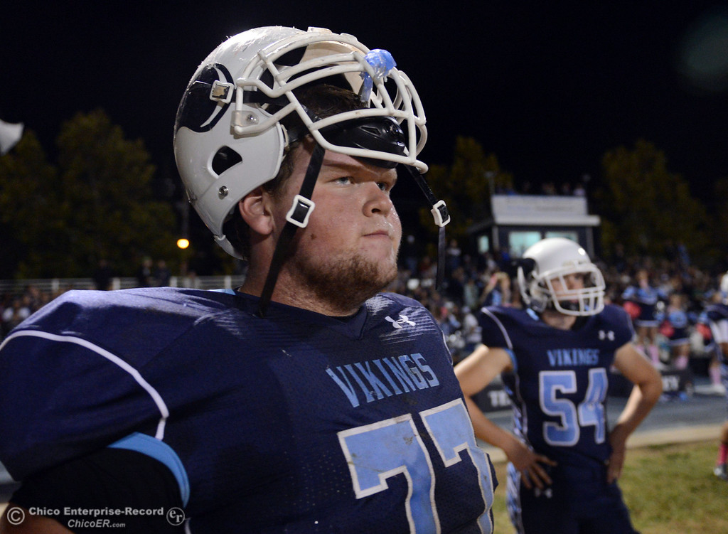 Description of . Pleasant Valley High\'s #77 Tyler Stimac looks on against Foothill High in the second quarter of their football game at PVHS Asgard Yard Friday, October 11, 2013 in Chico, Calif.  (Jason Halley/Chico Enterprise-Record)