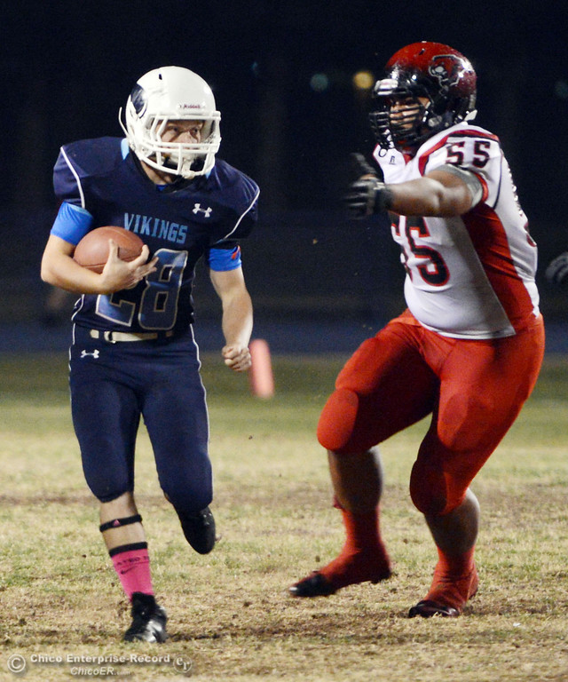 Description of . Pleasant Valley High\'s #28 Dylan Batie (left) rushes against Foothill High\'s #55 Willie Mitchell (right) in the first quarter of their football game at PVHS Asgard Yard Friday, October 11, 2013 in Chico, Calif.  (Jason Halley/Chico Enterprise-Record)
