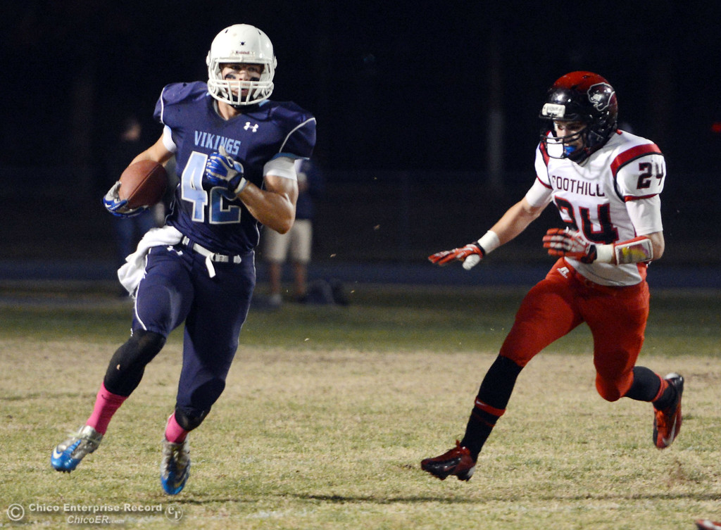 Description of . Pleasant Valley High\'s #42 Chad Olsen (left) rushes against Foothill High\'s #24 Logan Beebe (right) in the first quarter of their football game at PVHS Asgard Yard Friday, October 11, 2013 in Chico, Calif.  (Jason Halley/Chico Enterprise-Record)