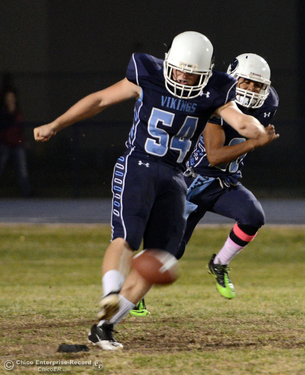 Description of . Pleasant Valley High\'s #54 Zack GIllam kicks off against Foothill High in the first quarter of their football game at PVHS Asgard Yard Friday, October 11, 2013 in Chico, Calif.  (Jason Halley/Chico Enterprise-Record)