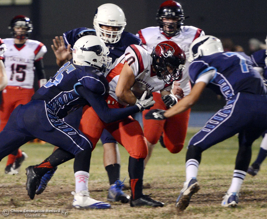 Description of . Pleasant Valley High\'s #25 Ryan Steindorf, #78 Alex Marquez, and #7 Zen Ferguson (left to right) tackle against Foothill High\'s #10 Blake Burnett (center) in the second quarter of their football game at PVHS Asgard Yard Friday, October 11, 2013 in Chico, Calif.  (Jason Halley/Chico Enterprise-Record)
