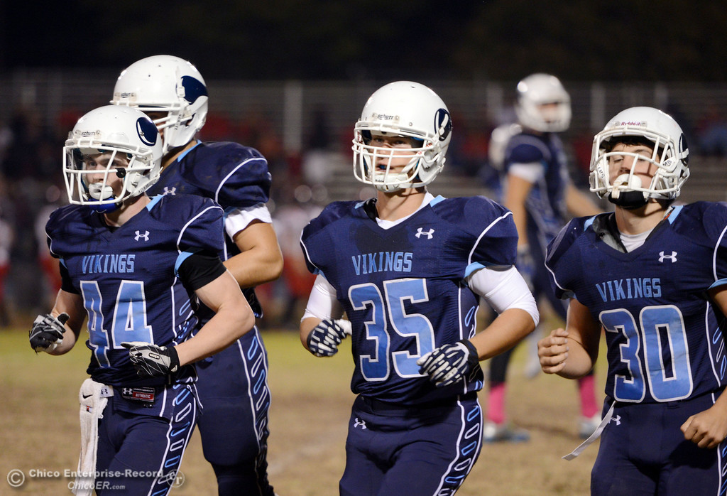 Description of . Pleasant Valley High\'s #44 Cyland Leitner (left) #35 Benjamin Whitmore (center) and #30 Connor Melton (right) come off the field against Foothill High in the first quarter of their football game at PVHS Asgard Yard Friday, October 11, 2013 in Chico, Calif.  (Jason Halley/Chico Enterprise-Record)