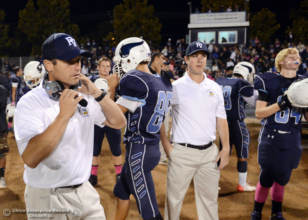 Description of . Pleasant Valley High coach Mark Cooley readies against Foothill High in the first quarter of their football game at PVHS Asgard Yard Friday, October 11, 2013 in Chico, Calif.  (Jason Halley/Chico Enterprise-Record)