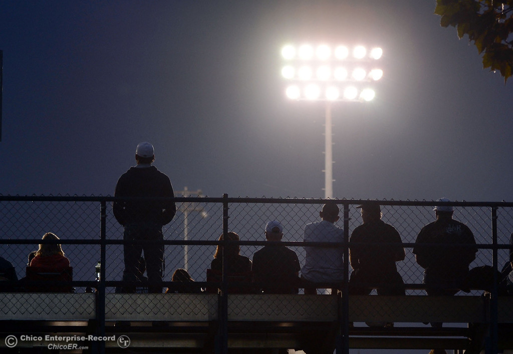 Description of . Fans watch under the lights Pleasant Valley High against Foothill High in the first quarter of their football game at PVHS Asgard Yard Friday, October 11, 2013 in Chico, Calif.  (Jason Halley/Chico Enterprise-Record)
