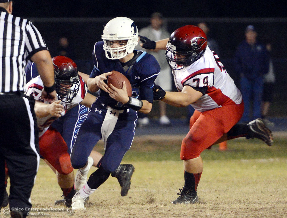 Description of . Pleasant Valley High\'s #12 Trent Darms (left) is tackled against Foothill High\'s #58 Kory Silva (left)  and #79 Wyatt Landreth (right) in the second quarter of their football game at PVHS Asgard Yard Friday, October 11, 2013 in Chico, Calif.  (Jason Halley/Chico Enterprise-Record)