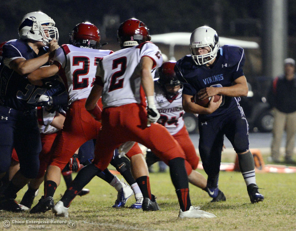 Description of . Pleasant Valley High\'s #9 Houson McGowan (right) rushes against Foothill High in the second quarter of their football game at PVHS Asgard Yard Friday, October 11, 2013 in Chico, Calif.  (Jason Halley/Chico Enterprise-Record)