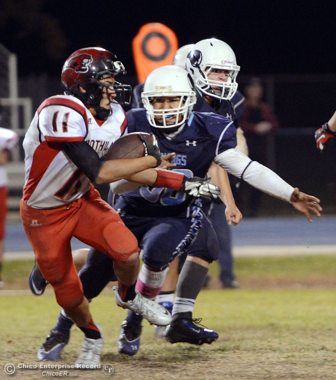 Description of . Pleasant Valley High\'s #56 Zariel Torres (right) tackles against Foothill High\'s #11 Ryan Terres (left) in the fourth quarter of their football game at PVHS Asgard Yard Friday, October 11, 2013 in Chico, Calif.  (Jason Halley/Chico Enterprise-Record)