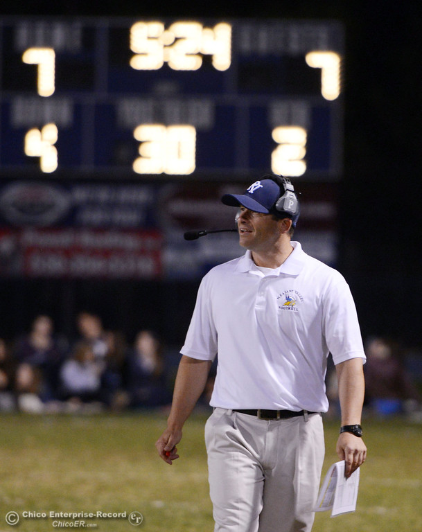 Description of . Pleasant Valley High\'s coach Mark Cooley looks on against Foothill High in the second quarter of their football game at PVHS Asgard Yard Friday, October 11, 2013 in Chico, Calif.  (Jason Halley/Chico Enterprise-Record)