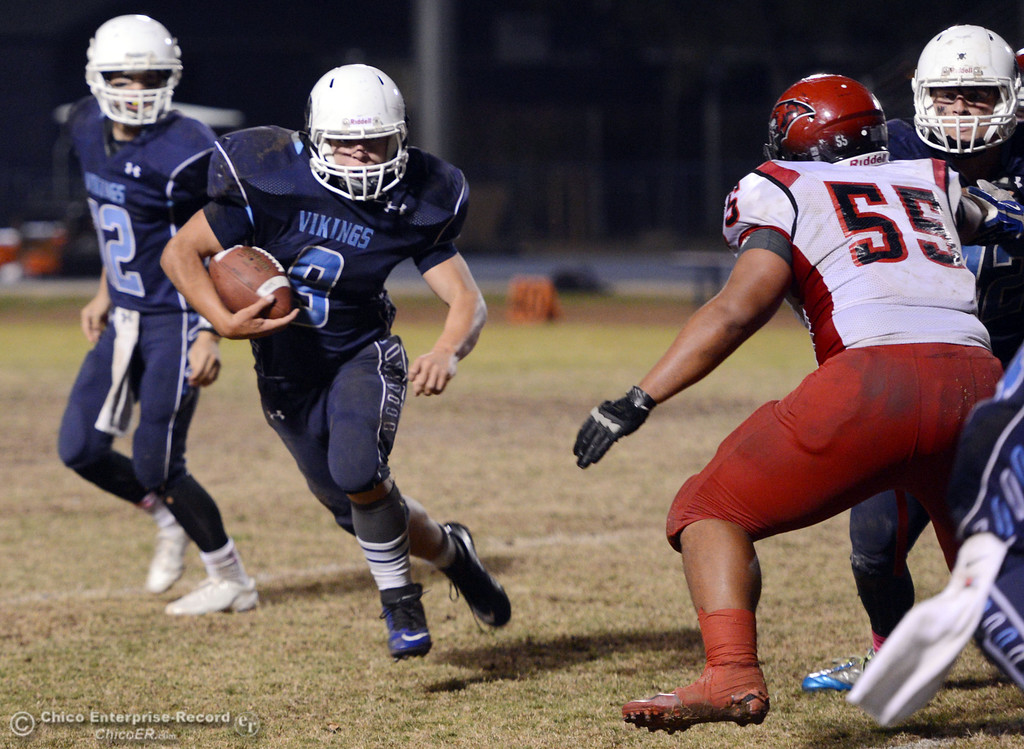 Description of . Pleasant Valley High\'s #9 Houston McGowan (left) rushes against Foothill High\'s #55 Willie Mitchell (right) in the third quarter of their football game at PVHS Asgard Yard Friday, October 11, 2013 in Chico, Calif.  (Jason Halley/Chico Enterprise-Record)