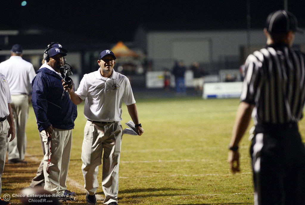 Description of . Pleasant Valley High\'s coach Mark Cooley (right) reacts to a call against Foothill High in the second quarter of their football game at PVHS Asgard Yard Friday, October 11, 2013 in Chico, Calif.  (Jason Halley/Chico Enterprise-Record)