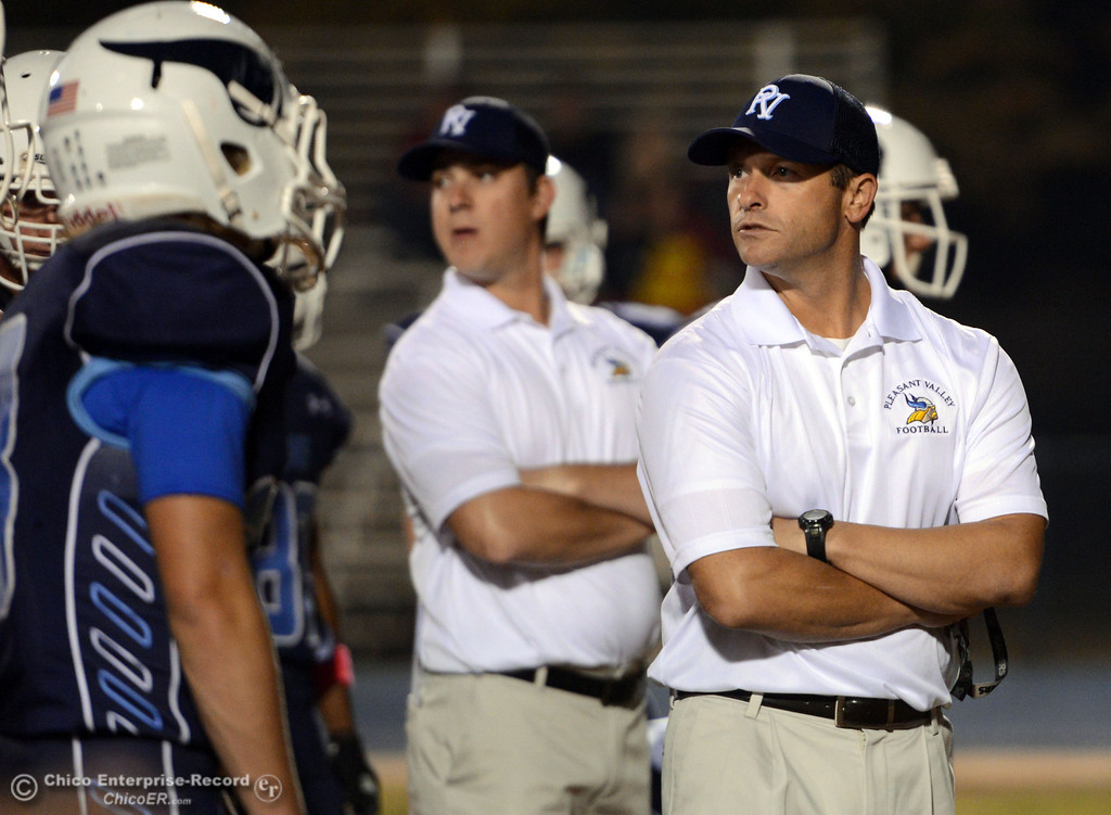 Description of . Pleasant Valley High head coach Mark Cooley looks on against Foothill High before the first quarter of their football game at PVHS Asgard Yard Friday, October 11, 2013 in Chico, Calif.  (Jason Halley/Chico Enterprise-Record)