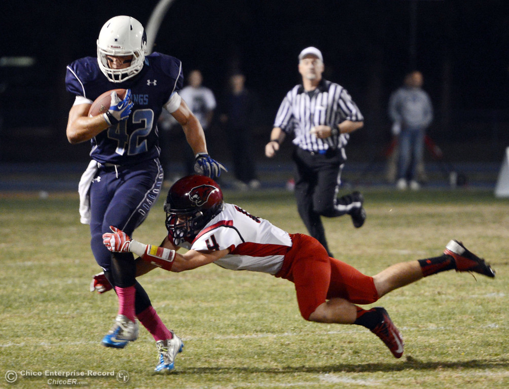 Description of . Pleasant Valley High\'s #42 Chad Olsen (left) breaks a tackle against Foothill High\'s #4 Luke Kelly (right) in the first quarter of their football game at PVHS Asgard Yard Friday, October 11, 2013 in Chico, Calif.  (Jason Halley/Chico Enterprise-Record)