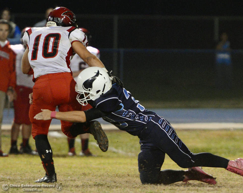 Description of . Pleasant Valley High\'s #33 Taylor Wright (right) tackles against Foothill High\'s #10 Blake Burnett (left) in the second quarter of their football game at PVHS Asgard Yard Friday, October 11, 2013 in Chico, Calif.  (Jason Halley/Chico Enterprise-Record)