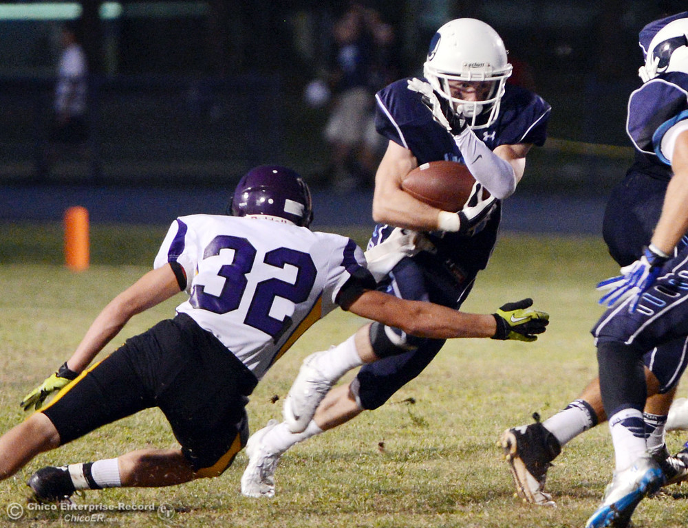 Description of . Pleasant Valley High's #44 Cyland Leitner (right) rushes against Lassen High's #32 Skyler Ingwerson (left) in the first quarter of their football game at PVHS Asgard Yard Friday, September 6, 2013 in Chico, Calif. (Jason Halley/Chico Enterprise-Record)