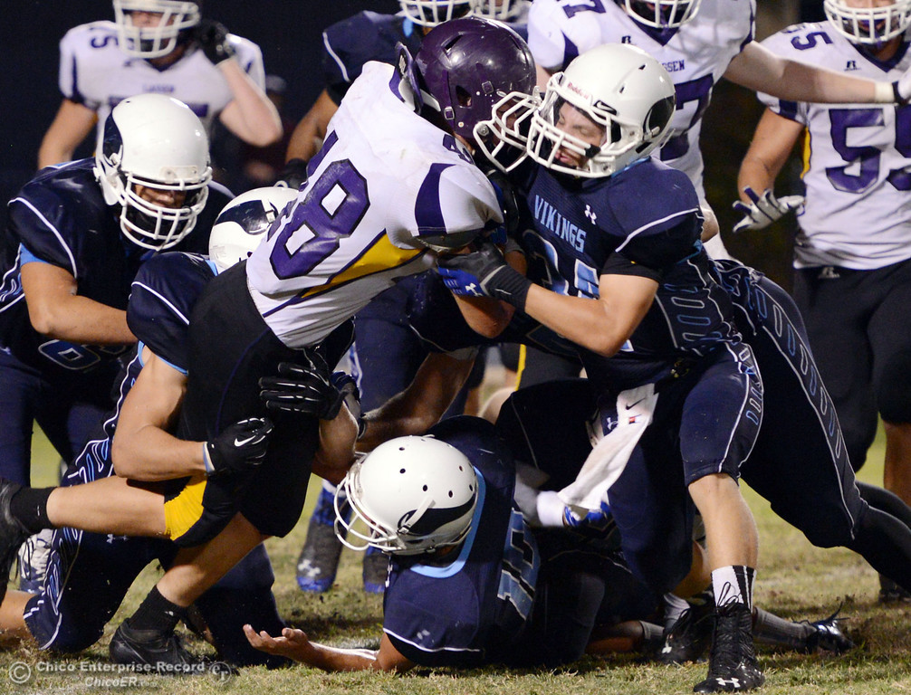 Description of . Pleasant Valley High's #34 Cale Crawford (right) tackles against Lassen High's #48 Kyle Barnetche (left) in the third quarter of their football game at PVHS Asgard Yard Friday, September 6, 2013 in Chico, Calif. (Jason Halley/Chico Enterprise-Record)
