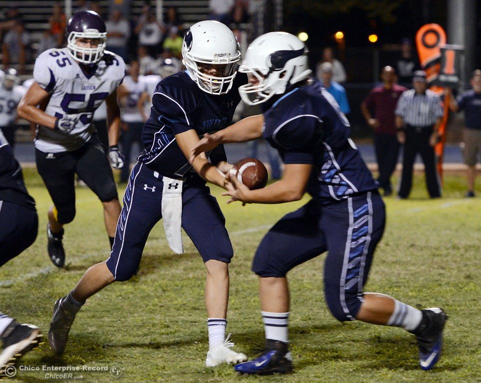Description of . Pleasant Valley High's #12 Trent Darms (left) hands off to #9 Houston McGowan (right) against Lassen High in the third quarter of their football game at PVHS Asgard Yard Friday, September 6, 2013 in Chico, Calif. (Jason Halley/Chico Enterprise-Record)