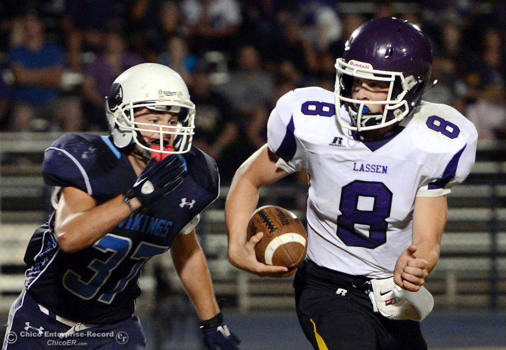 Description of . Pleasant Valley High's #37 Garett Greenwald (left) moves in to sack Lassen High's #8 Jordan Atkinson (right) in the fourth quarter of their football game at PVHS Asgard Yard Friday, September 6, 2013 in Chico, Calif. (Jason Halley/Chico Enterprise-Record)