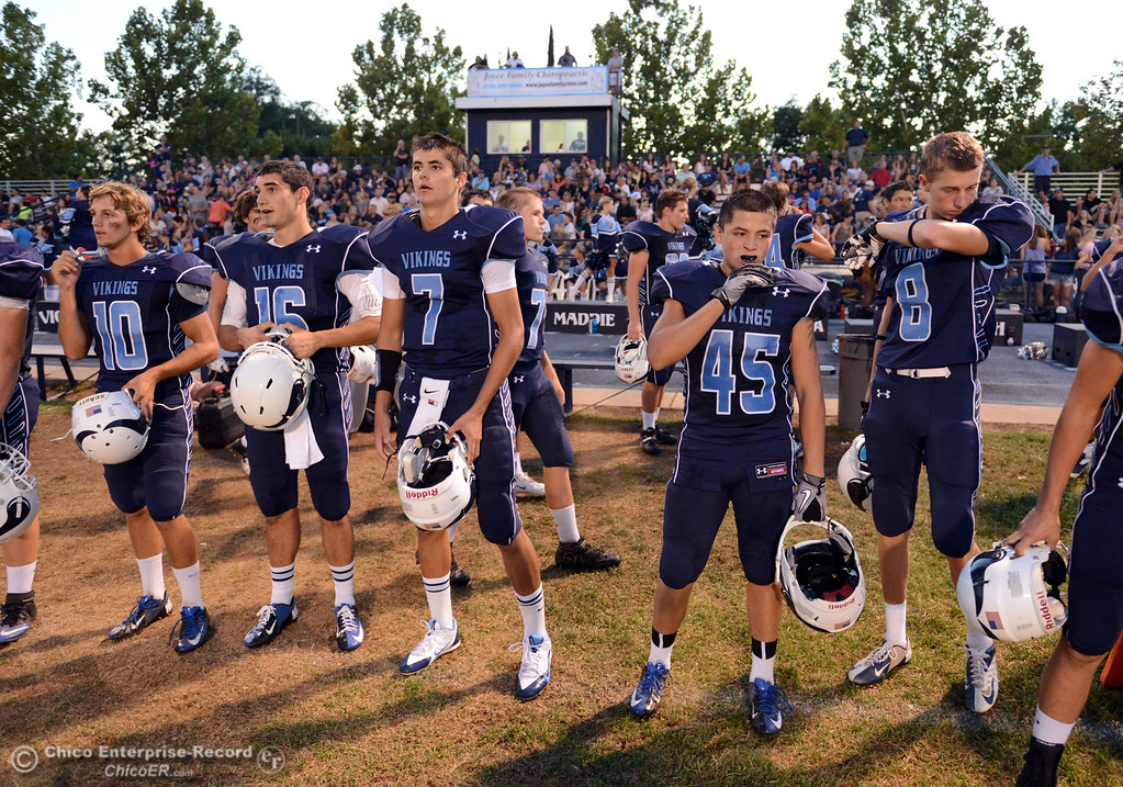 Description of . Pleasant Valley High prepares against Lassen High before the first quarter of their football game at PVHS Asgard Yard Friday, September 6, 2013 in Chico, Calif. (Jason Halley/Chico Enterprise-Record)