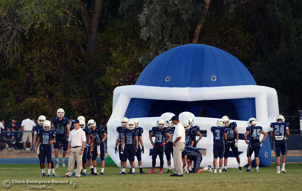 Description of . Pleasant Valley High warms up against Lassen High before the first quarter of their football game at PVHS Asgard Yard Friday, September 6, 2013 in Chico, Calif. (Jason Halley/Chico Enterprise-Record)