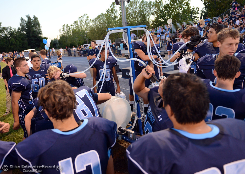 Description of . Pleasant Valley High team grabs water before the first quarter of their football game against Lassen High at PVHS Asgard Yard Friday, September 6, 2013 in Chico, Calif. (Jason Halley/Chico Enterprise-Record)