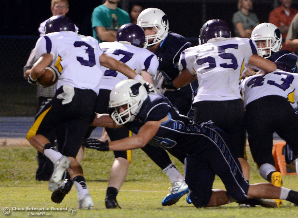 Description of . Pleasant Valley High's #88 Zack Suttles (right) tackles against Lassen High's #3 Quinn Thompson (left) during the second quarter of their football game at PVHS Asgard Yard on Friday, September 6, 2013 in Chico, Calif.  (Jason Halley/Chico Enterprise-Record)