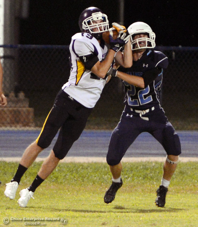 Description of . Pleasant Valley High's #19 Reece Maddox (right) is unable to break up a pass against Lassen High's #19 Franky Shepherd (left) in the second quarter of their football game at PVHS Asgard Yard Friday, September 6, 2013 in Chico, Calif. (Jason Halley/Chico Enterprise-Record)
